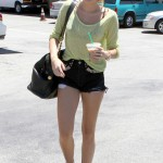 Miley Cyrus shows off her new red 'do while hitting up Starbucks in super-short jeans shorts and a sheer top Los Angeles 06/25/2012